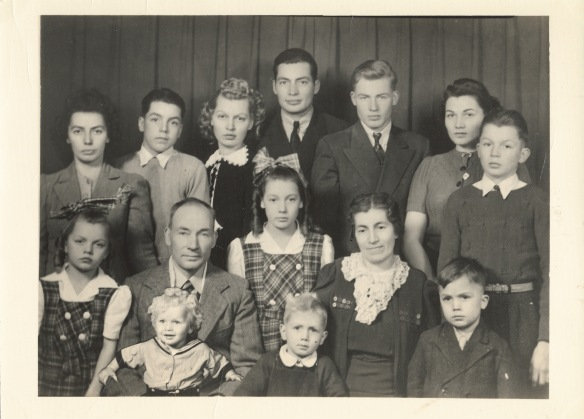 8. Great Grandma Gudrun and Great Grandpa Severin Linseth and their 12 children Edith Linseth Veeder is center in the plaid